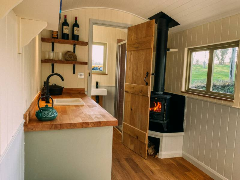 The shepherd's huts are fully en suite and have a hot tub outside.